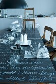 Punchbowl and glasses on blackboard table top with white lettering