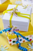 Flower shapes punched out of maps decorating gift parcels