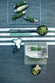 Top view of purist place setting with fish wrapped in leaves and unusual accessories