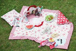 Hand-sewn picnic blanket and bag on lawn