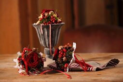 Hand-made Christmas posies of roses and spices