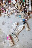 Many used tubes of paint on concrete floor