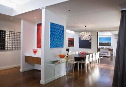 Collection of artworks in open-plan 60s-style interior of Australian house