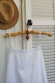 Vintage undershirt on rustic coathanger made from stripped, oiled branch with leather strap