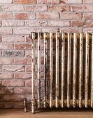 Vintage radiator on brick wall