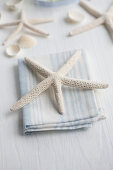Dried starfish on linen napkin