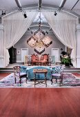 Stylish interior with seating, curtains, chandelier and stage lighting rigs