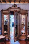 Antique, mirrored wardrobe with secret door