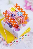 Gift boxes decorated with silk cord and confetti