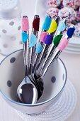 Cutlery with felt confetti stuck on handles