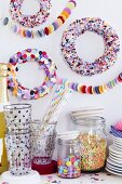 Party buffet with colourful confetti wreaths decorating wall