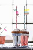 Drinking straws with washi tape flags stuck in muffins