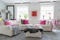 White, feminine interior with sparse accents of pink and red