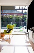 Sunny interior with floor-to-ceiling sliding doors leading to sun terrace