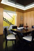 Black, Art-Deco dining set in wood-panelled dining room