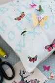 Hand-sewn pin cushion with butterfly motifs