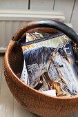 Horse magazine in basket on floor