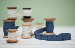 Printed ribbons wound on vintage wooden reels