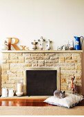 Fireplace with stone surround and ornaments on mantelpiece