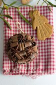 Spice bauble and almond biscuit on gingham cloth