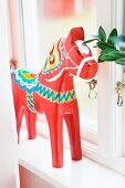 Painted wooden horse on windowsill