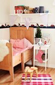 Animal-shaped, child's stool on floor in front of white bedside table and wooden, child's bed in rustic bedroom