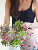 Young woman arranging summer flowers
