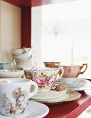 Vintage teacups and saucers wiith various patterns