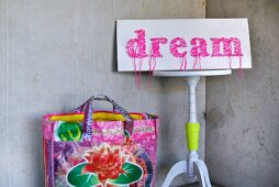 DIY sign with pink string art motto