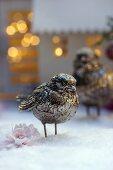 Bird ornament on artificial snow