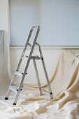 A step ladder and dust sheet