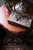 Reading glasses and book on delicate side table