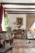 Antique period furniture, carved horse on stand and dog sitting on Oriental rug in parlour