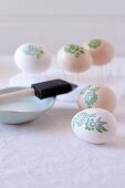 Decorating Easter eggs with botanical patterns using decoupage technique