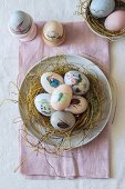 Easter nest of eggs decorated with animal motifs
