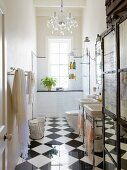 Narrow bathroom with glossy chequered floor, vintage-style sink and shower area