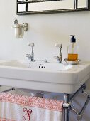 Washstand with vintage-style metal frame, taps and beaker bracket on wall