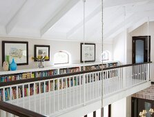 Bookcase in built into low knee wall on gallery