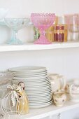 Crockery in white, shabby-chic, glass-fronted cabinet