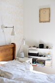 Wooden bed, bedside cabinet, full, white String shelves and child's drawing in gilt frame