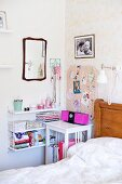 Bed, white bedside table, feminine pin board and String shelving on wall