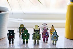 Miniature robot toys on windowsill