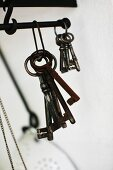 Bunches of vintage keys hanging from metal rod