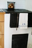 Old, masonry kitchen stove with oven