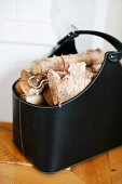 Black leather bag of firewood