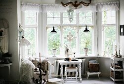 Bay window with translucent pelmet and white, traditional side table and matching stool