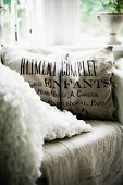 Scatter cushion with printed linen cover on armchair
