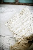 Cushion with white ruffled cover