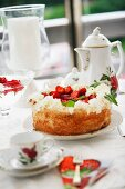 Strawberry cake with cream and coffee service with nostalgic pattern