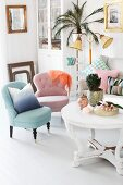 Pastel easy chairs, white, round coffee table with carved base, standard lamp and potted palm on plant stand